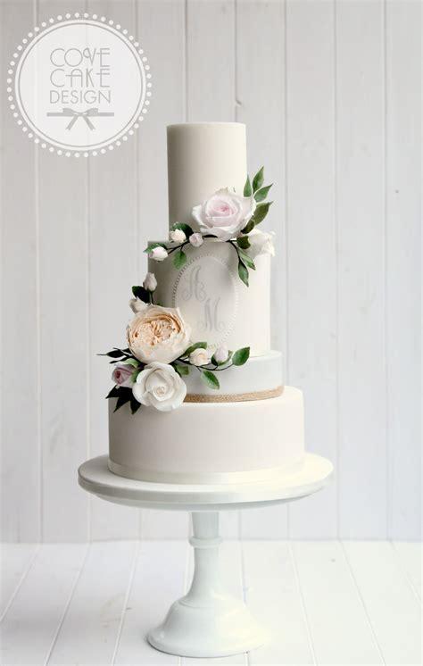 Contemporary wedding cake with custom monogram and sugar