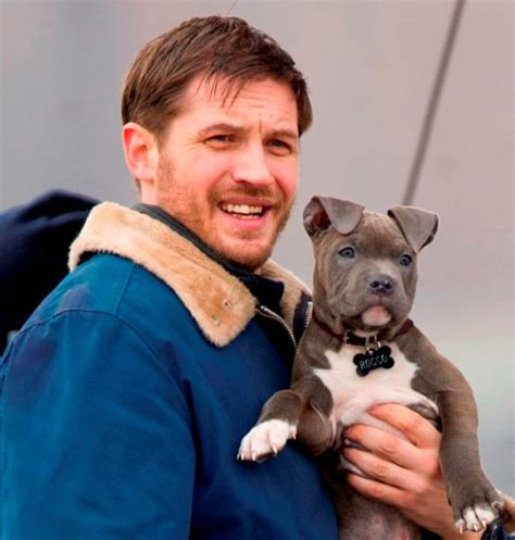 tom hardy puppy tom hardy cuddles a puppy on the set of animal rescue lainey gossip entertainment update