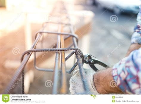of worker using a silicone for repairing in the
