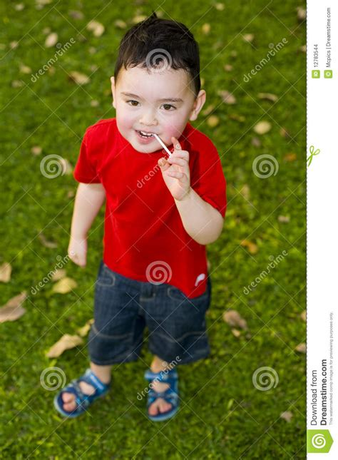 Lolli Boy | boy with lolli in the park stock images image 12783544
