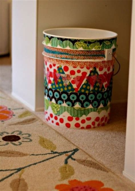 Decoupage Plastic Container - use fabric scraps to decoupage a garbage can craft