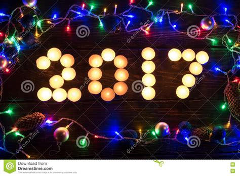 happy new year 2017 written with burning candles stock