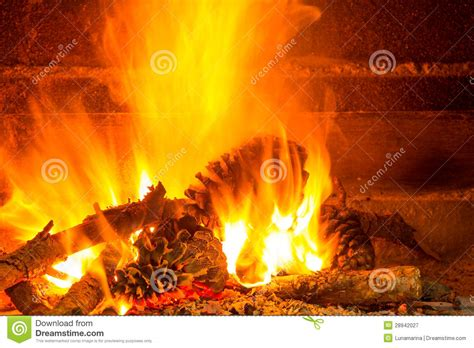 Burning Pine In Fireplace by Burning Firewood In Chimney With Pine Cones Royalty Free