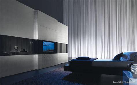 modern bedroom wardrobe with a tv built in the door