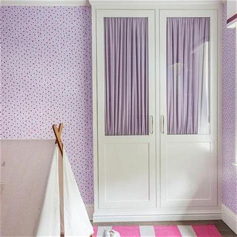 gray and pink bedroom with two tone nightstand gray headboard with purple polka dot bedding