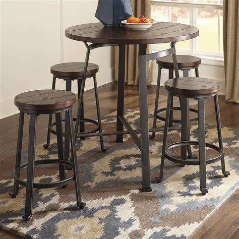 round pub table and chairs signature design by ashley challiman 5 piece round counter