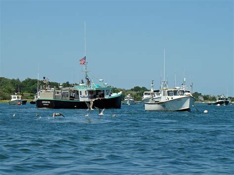 boats cape cod sleepy boats at chatham cape cod ma photograph by