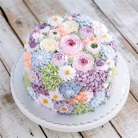Cake Decorating Flowers Buttercream by Buttercream Wedding Cake Covered In Flowers By