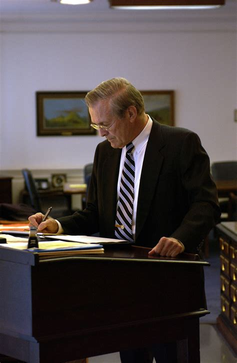 file donald h rumsfeld works at a stand up desk jpg