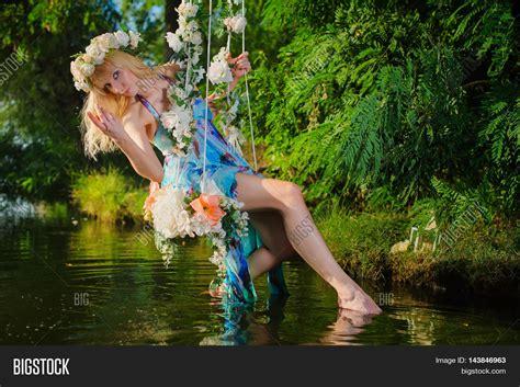 girl swings girl on home made tree swing over image photo bigstock