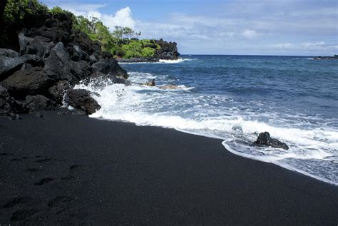 beach with black sand black sand beach by louie hooper