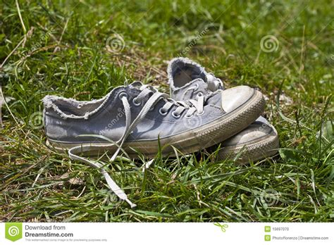 used shoes used shoes in meadow stock photo image 15697070