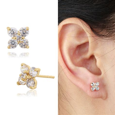 Chil Kid Gold 18k yellow gold plated clear 4 petal flower zircon cz stud