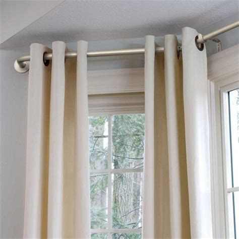 hanging curtains in a bay window bay window curtain rod improvements catalog