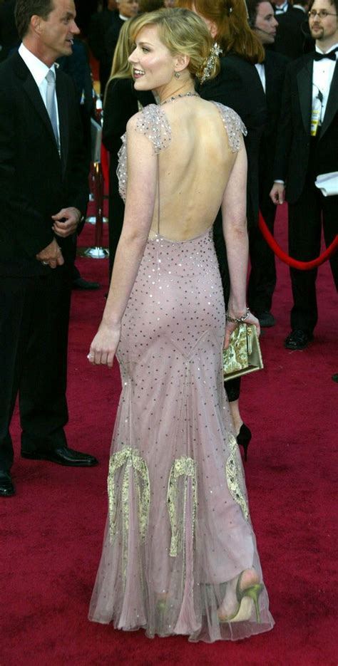 Worst Dressed Of The Day Kirsten Dunst Oscars Edition by Kirsten Dunst In Sequined Dress By Galliano At The