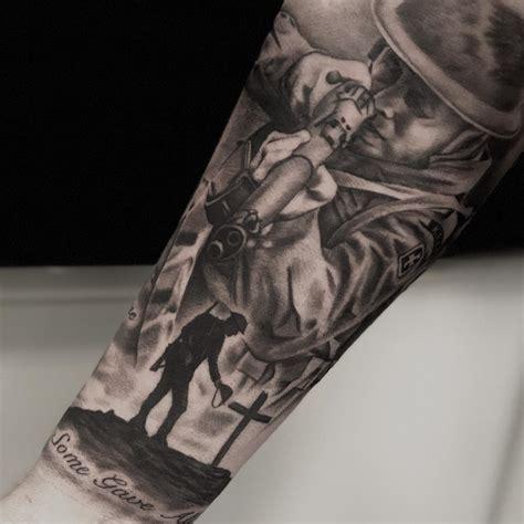 tattooed soldier armed soldier cross veteran ink