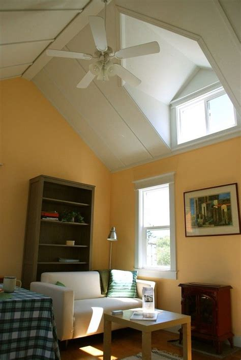 Livingroom Windows vaulted ceilings with dormers make the living room feel