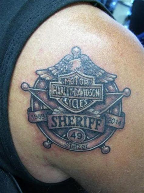 shoulder logo harley davidson tattoo by inxon tattoo