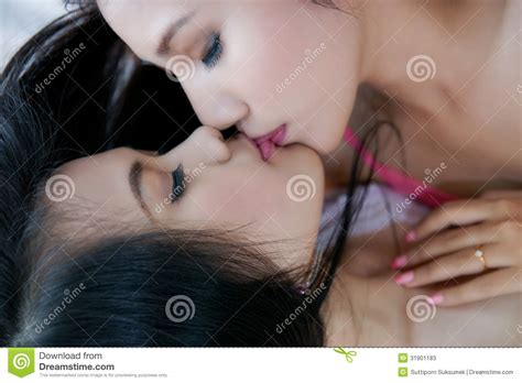 kissing on the bed women kissing stock photos image 31901183