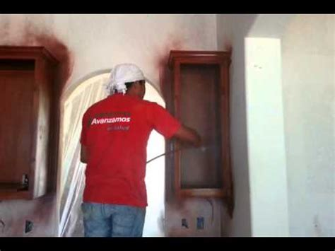 spraying lacquer finish on cabinets spraying lacquer on wood cabinet doors with an airless