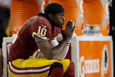 why is rg3 benched robert griffin iii rg3 knee injury a warning sign for his