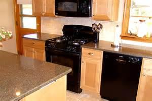 maple kitchen cabinets with quartz countertop