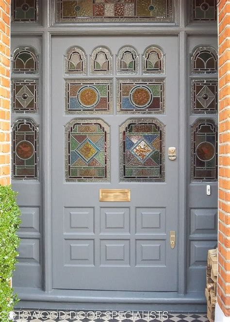 ornate victorian front door  frame  stained glass
