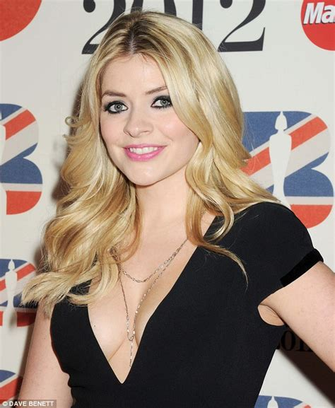 35 year old female celebs holly willoughbotty shows off her figure in tight jeans