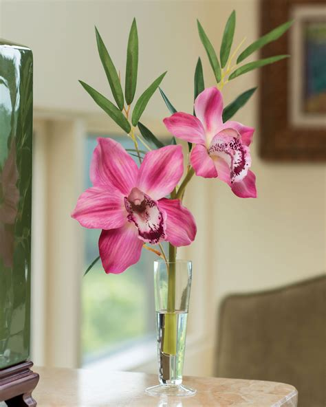 soft yellow red cymbidium silk orchids floral arrangment cymbidium silk orchid bamboo arrangement at petals