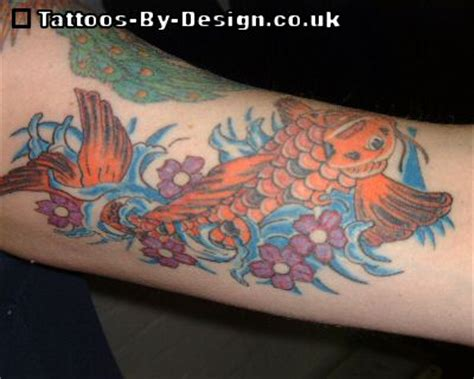 small koi tattoo small koi fish on wrist