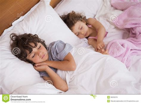 and boy sleeping in bed stock image image 39232279