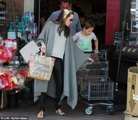 angelina jolie brings son knox to military supply store picture exclusive angelina jolie gets a hand from son