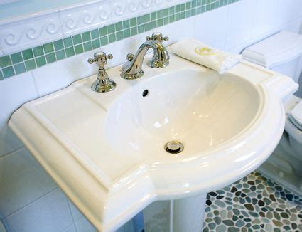 how to use straightener pedistal sink no countertop how to replace and install a bathroom vanity and sink