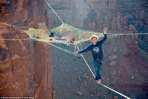 andy lewis suspends web of tightropes 400ft above utah