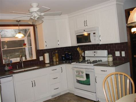 Backsplash For Kitchen With White Cabinet by White Cabinets Black Granite Countertops White Subway Tile