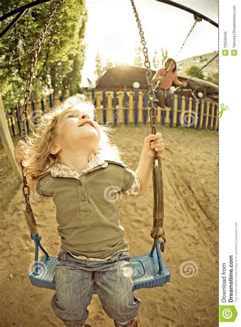child on swing child on swing in summer royalty free stock photo image