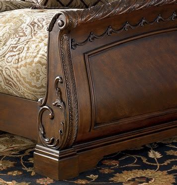 north shore queen sleigh bed from ashley b553 77 74 75 coleman north shore queen sleigh bed by ashley home gallery stores