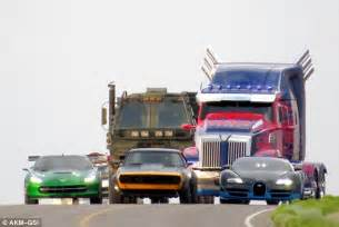 new cars in transformers 4 optimus prime gets an upgrade in transformers 4 as