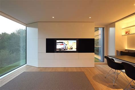 prefab swiss alps house designed to look like boulder
