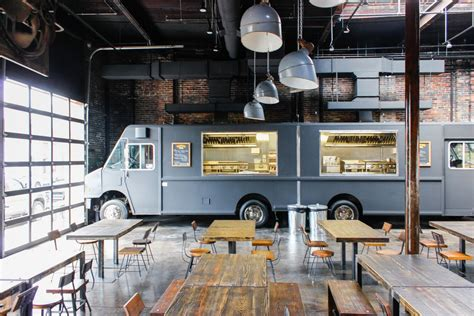food truck boston design center settle onto a patio and eat from indoor food trucks this
