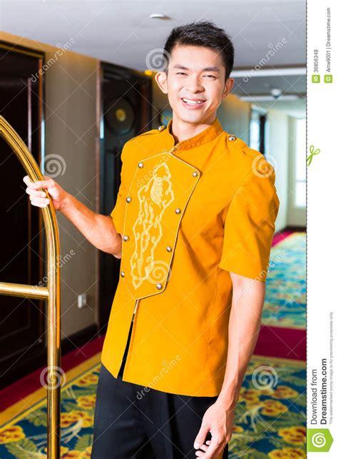 Free 3d Room Design asian bell boy or porter bringing suitcase to hotel room
