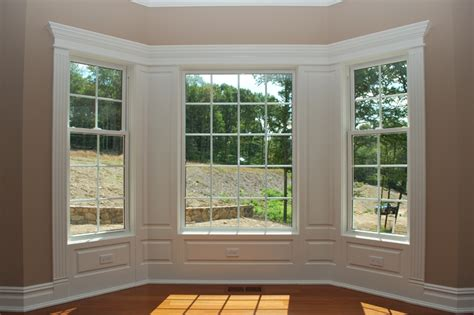 decorative interior windows integrate window and door trim with wainscoting panels