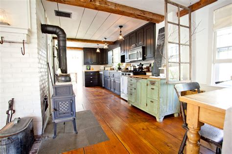 farmhouse floors vinyl wood plank flooring kitchen farmhouse with brick walls ceiling beams exposed wood beams