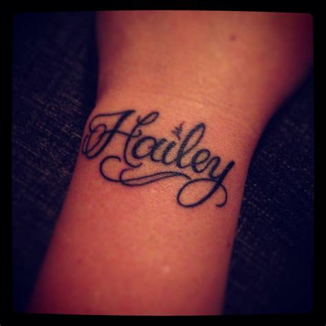 wrist tattoo name daughters name on left wrist my