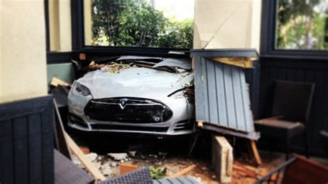 Tesla Restaurant Tesla Model S Crashes Through Restaurant Driver Blames It