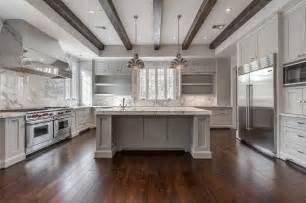 Tray Ceiling Wood Beams White And Gray Kitchen Features A Tray Ceiling Lined With
