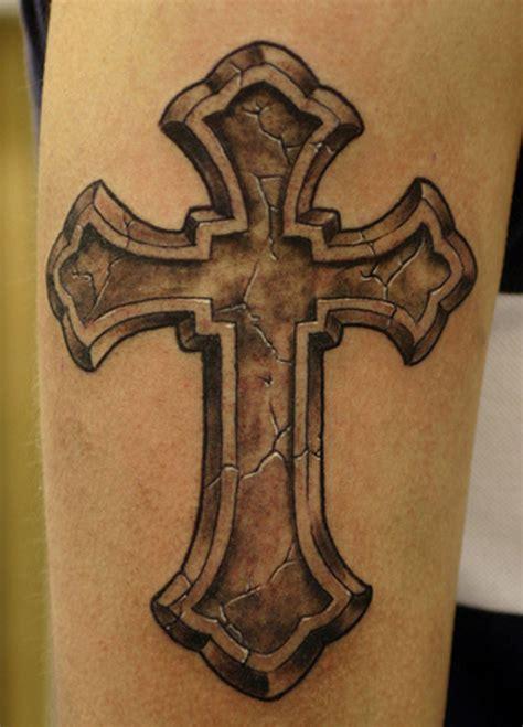 cross tattoo on bicep grey ink 3d cross on bicep