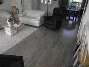 grey floor living room living room with grey tiles