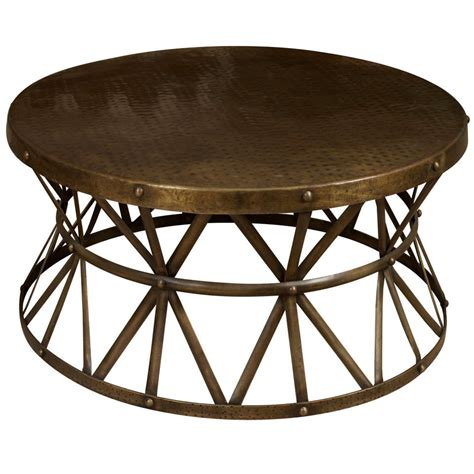 A round metal coffee table at 1stdibs
