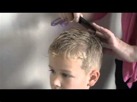 cutting boy hair with scissors how to cut men s hair scissor over comb barbering